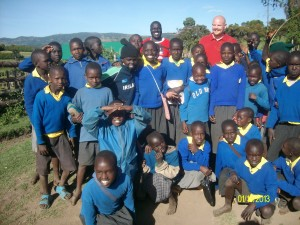Carl Willis with school children in Kenya
